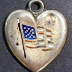 enamel version of a flag on heart charm circa 1940
