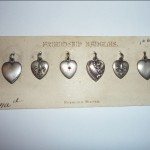 prime example of an original advertising card from circa 1900 with puffy heart charms