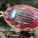 rare scarab charm made from a louis comfort tiffany favrile glass scarab set in 14K gold