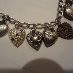 Vintage Sterling Puffy Heart Bracelet with 16 Petite Heart Charms