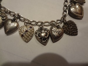 sterling puffy heart bracelet with 16 heart charms